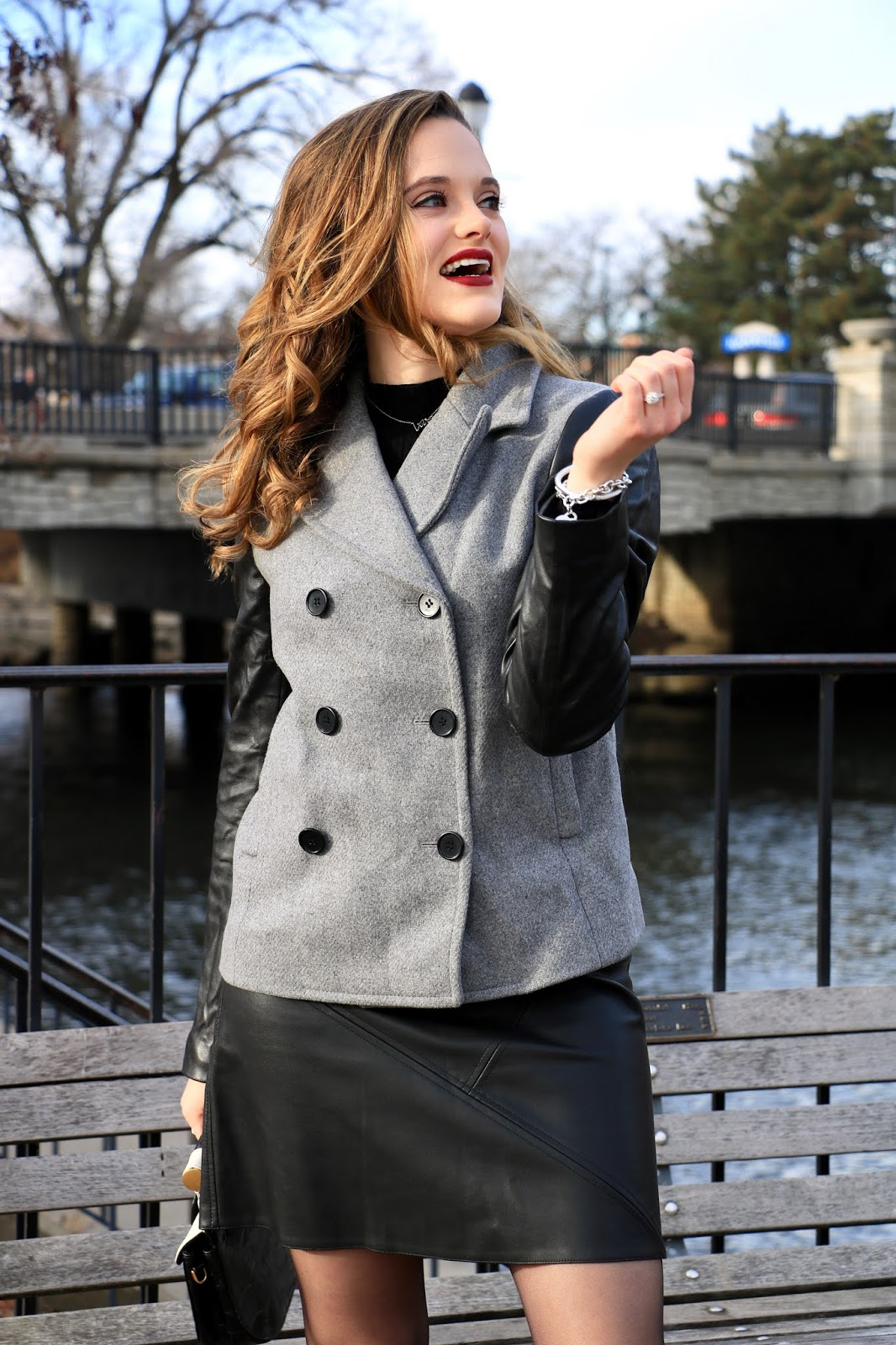 Nyc fashion blogger Kathleen Harper wearing a peacoat and leather mini skirt in winter 2020.