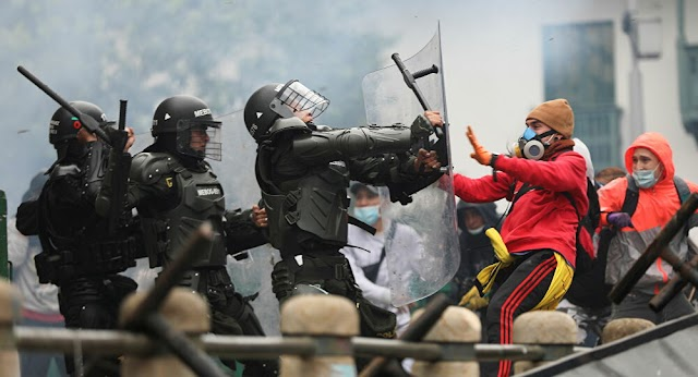 Colombia's tax reform plan has resulted in riots with 50 injured officers in the country's largest cities.