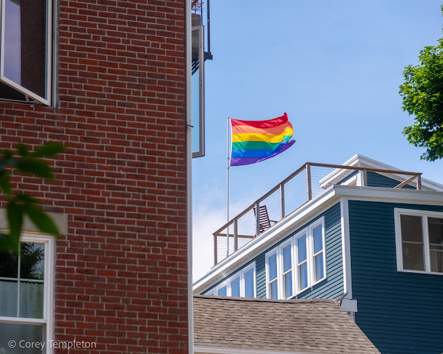Portland, Maine USA June 2021 photo by Corey Templeton. A pride flag enjoying the breeze high above the West End.