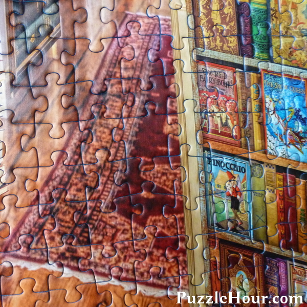 Fantasy Bookshop Ravensburger Jigsaw Puzzle Aimee Stewart rug, wood floor and books