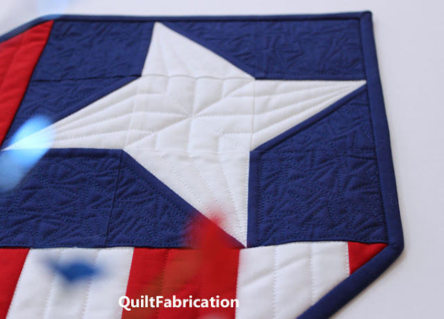 closeup of line quilting in a friendship star