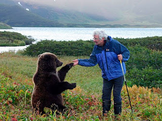 Charlie Russell with one of his adopted grizzly bear cubs