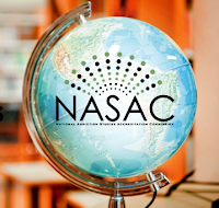 Image of a globe in a classroom, NASAC logo keyed into globe.
