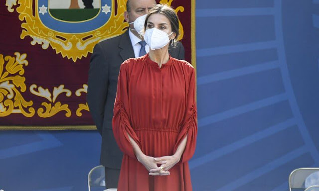 Queen Letizia of Spain wore a red long sleeve flared midi dress by Salvatore Ferragamo