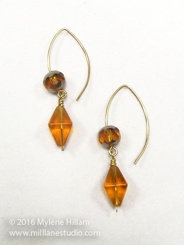Amber glass bead drop earrings on elfin earring wire.