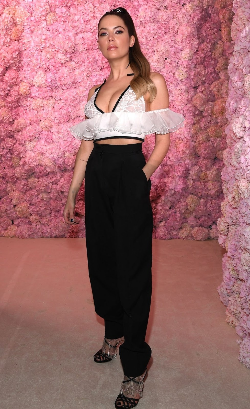 Ashley Benson flaunts cleavage in lace cropped top at the Giambattista Valli Paris Fashion Week Show