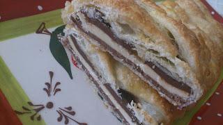 trenza hojaldre rellena chocolate milka valor clavileño horno negro con leche blanco sencilla rica cuca desayuno postre merienda