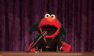 Elmo disguises himself as The Count. Sesame Street Count On Elmo