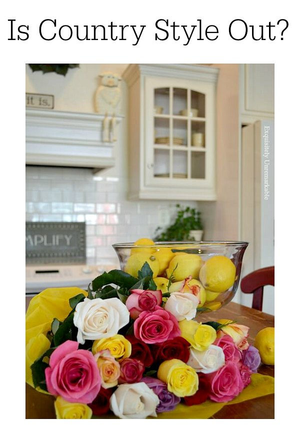 Is Country Style Out Of Style? Text over photo of country style kitchen with roses and lemons