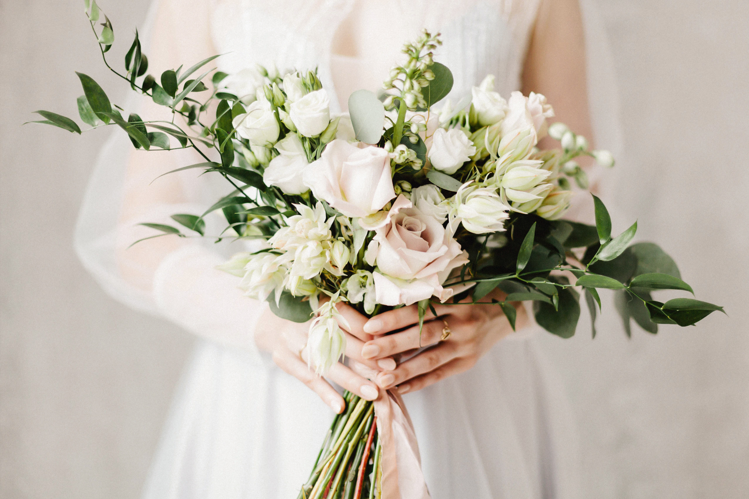 a picture of a womans hands holding fall wedding bouquet