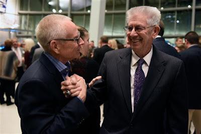 Mark Martin (left) greets NASCAR Hall of Famer Leonard Wood.