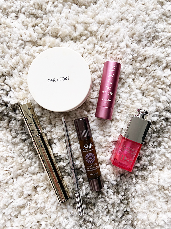 Empty beauty products from Oak + Fort, Dior, Clarins, Saje, and Fresh