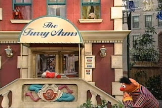 Ernie finds a key in front of The Furry Arms Hotel. Sesame Street 123 Count with Me