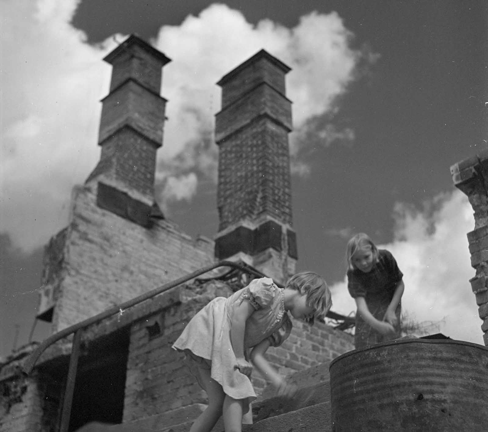Two girls, in ruins near Martin's Church in Turku, Finland.
