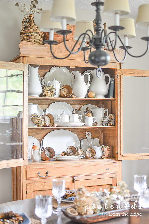 vintage oak hutch with thrift store white ironstone pitchers and platters