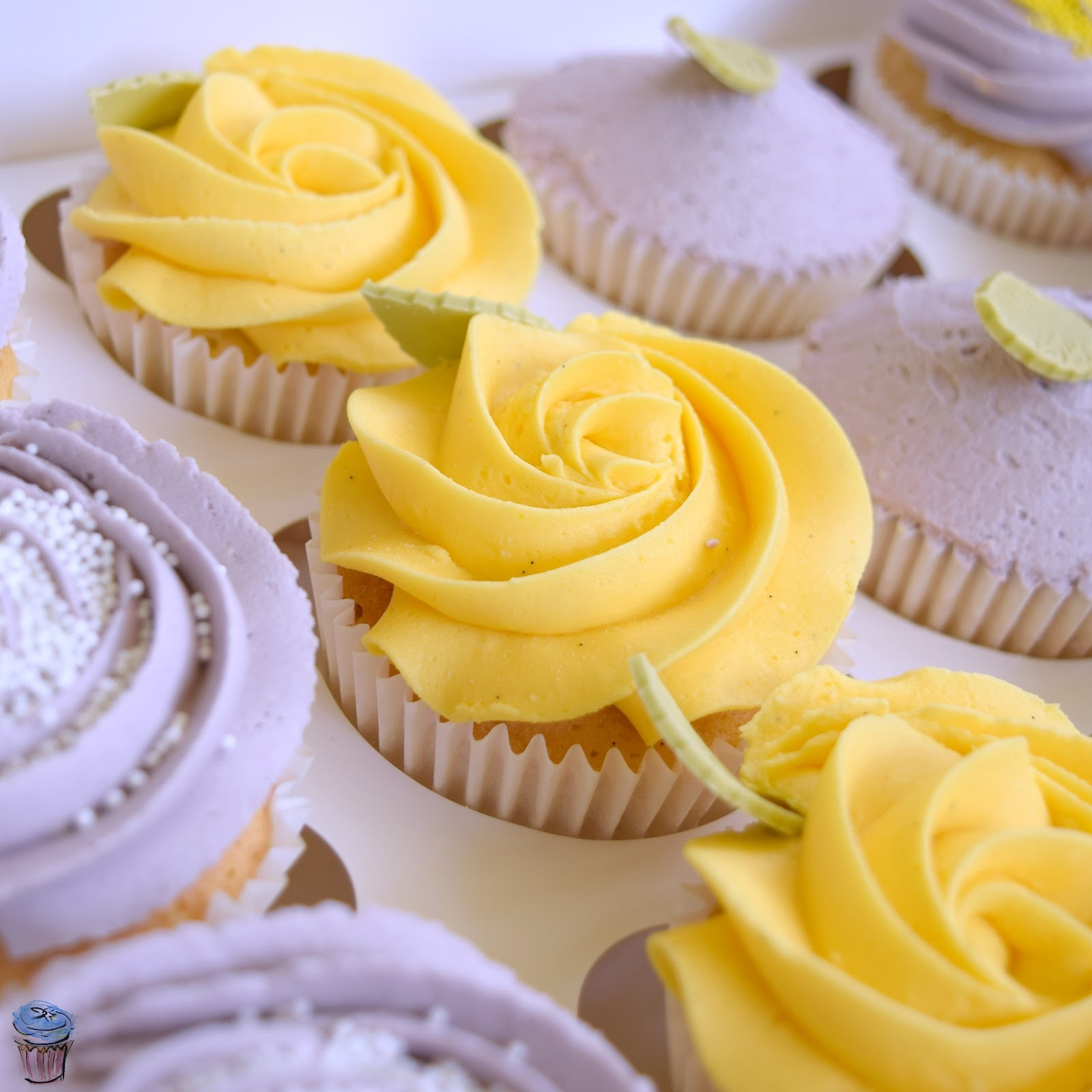 Yellow buttercream cupcake design with leaf and star closed nozzle dairy free
