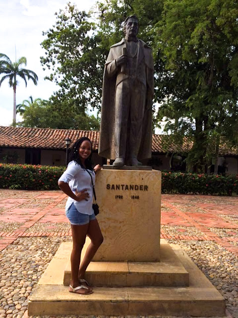 girl standing in front of statue