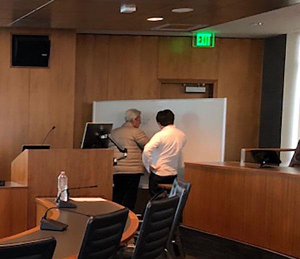 Yakir Aharonov helping participant at Chapman University Quantum Studies Workshop
