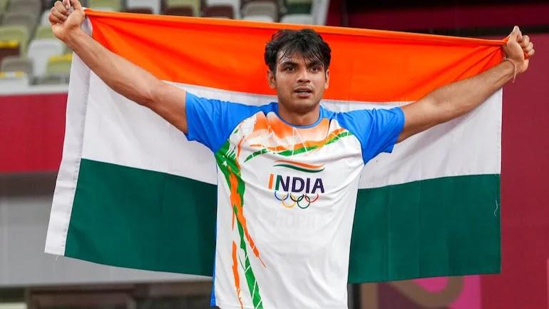 Neeraj Chopra with India's Flag