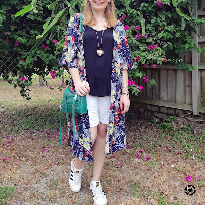 awayfromtheblue Instagram | black and white peplum tee Bermuda shorts outfit with red printed floral kimono and green crossbody bag