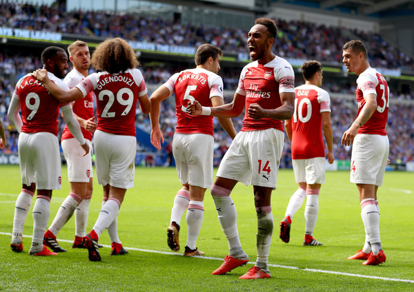 Pierre-Emerick Aubameyang of Arsenal celebrates after scoring his team's second goal with team mates during the Premier League match between Cardiff City and Arsenal FC at Cardiff City Stadium on September 2, 2018 in Cardiff, United Kingdom.
