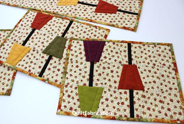 fall color tumblers on leaf fabric