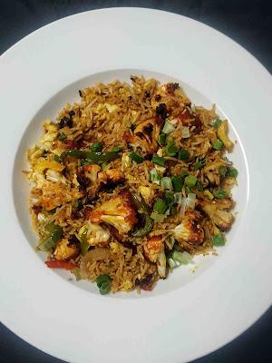 Serving cauliflower Manchurian fried rice