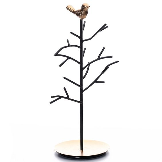 A metal jewelry display rack with a gold bird accent on top.