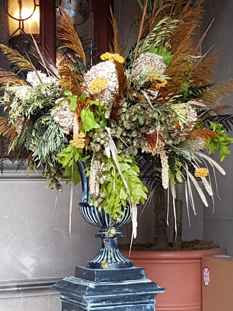 dried flowers and foilage in floor urn