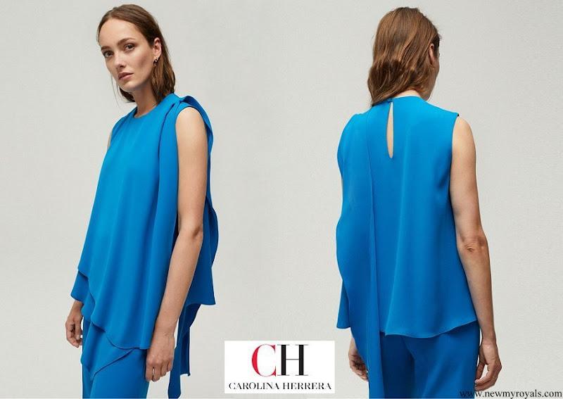 Queen Mathilde wore Carolina Herrera asymmetric top with ruffle