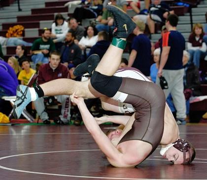 St. Joseph-Ogden's Austin Upton wrestles Joliet Catholic's Michael Gruben