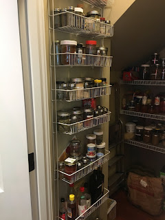 Walk-in pantry with shelves of glass storage spice jars full of vegan (whole food plant-based) foods https://trimazing.com/