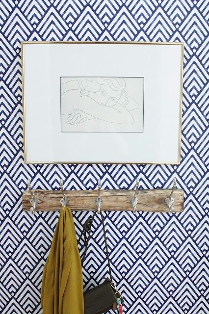 Wallpapered entryway with artwork by Lindsey Crafter