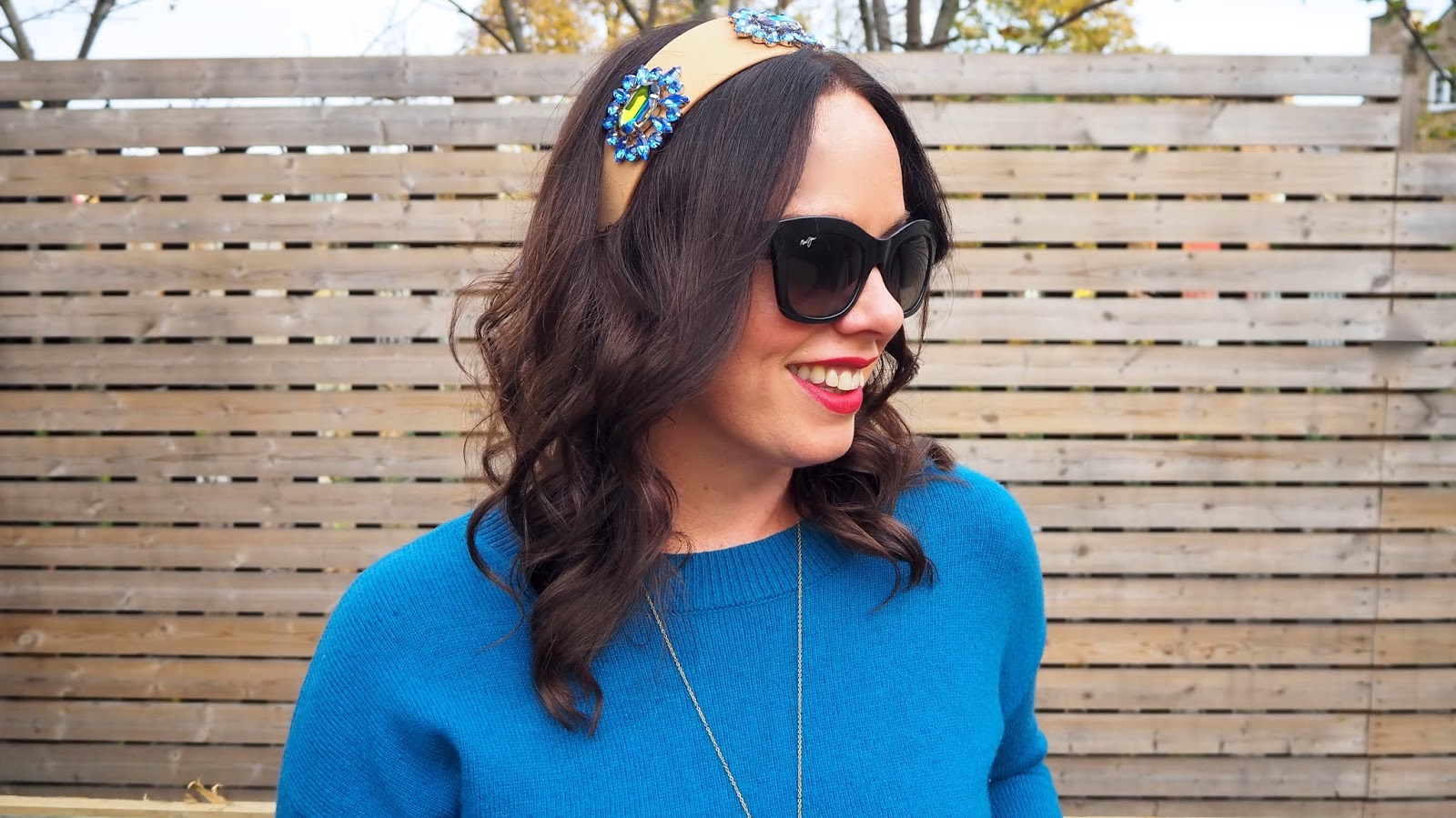 Asos tan headband with blue and green jewels on it