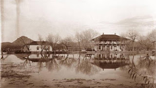 Old black and white picture of two houses by a lake. AZ Historical Society 1888