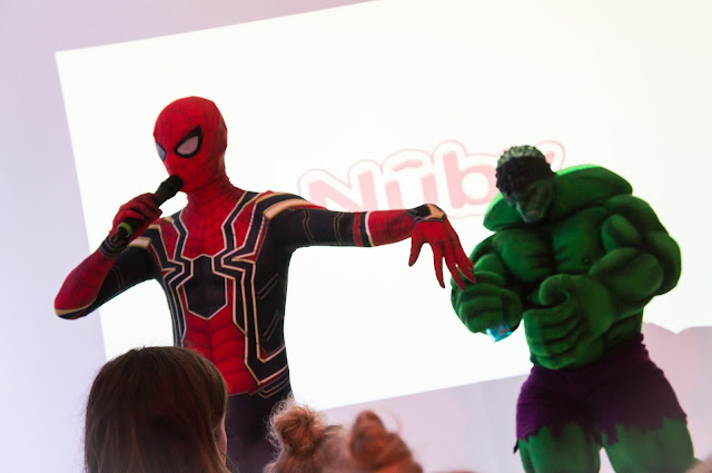 life size spiderman and the hulk performing at nuby big reveal event