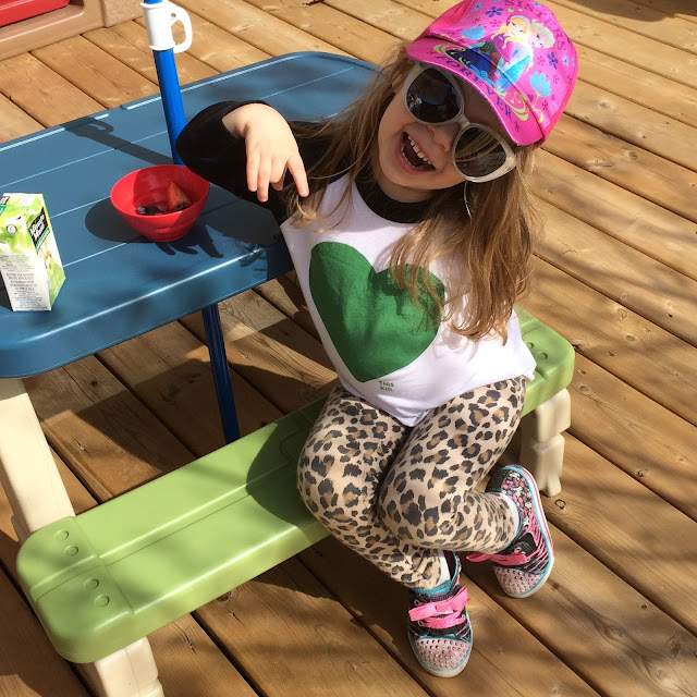 toddler chilling on the patio
