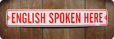 English Spoken Here sign