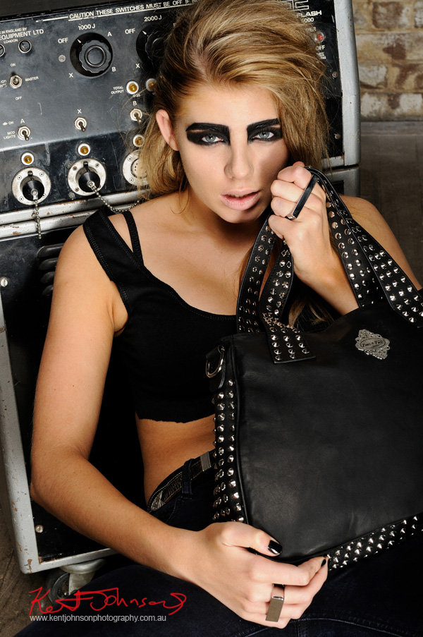 Modelling handbags, colour close up. Biker Chick Chic with Gothic overtones fashion accessories, marketing and adverting photography Sydney.