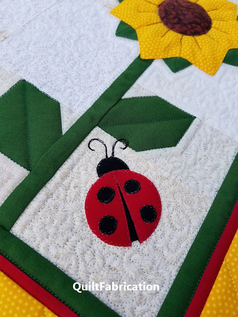 sunflower and lady bug quilted table runner by QuiltFabrication