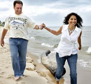 Lupe Marinez Izzo holding hand of her spouse Tom Izzo