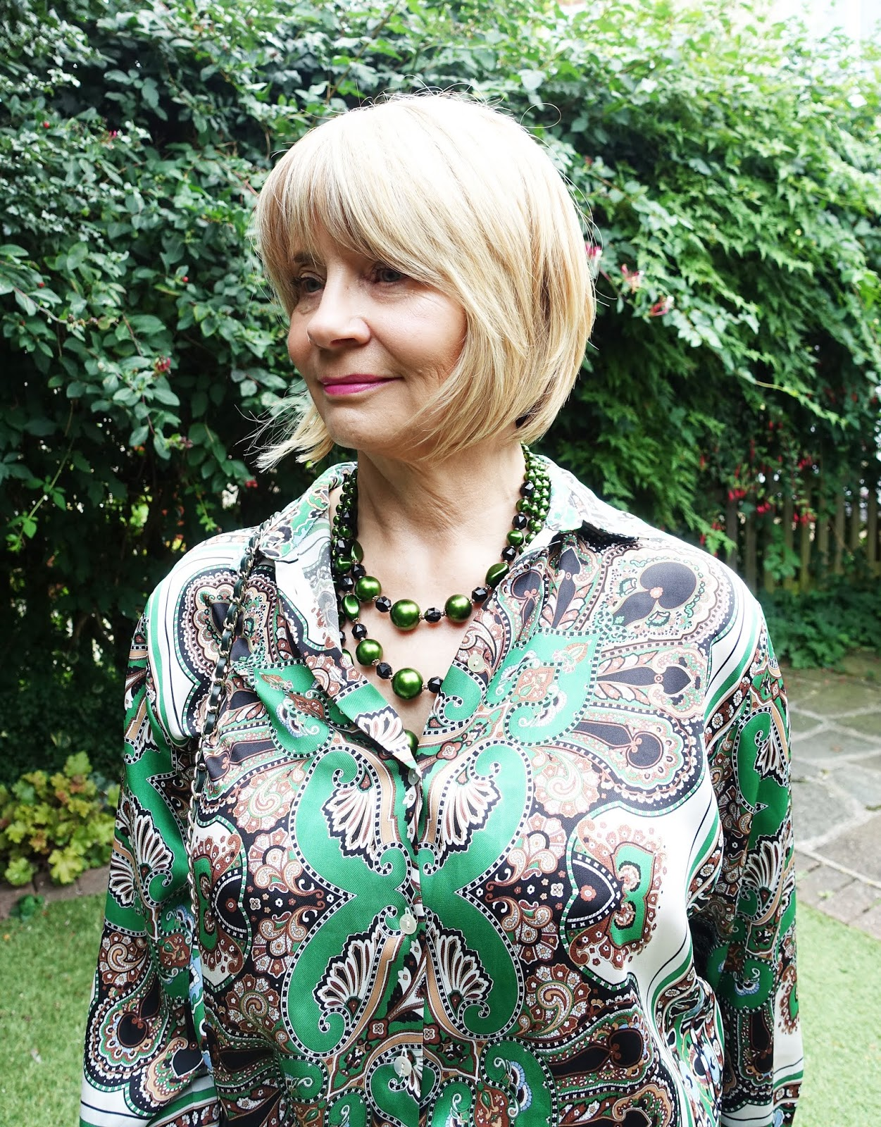 Vintage green beads add a quirky touch to a paisley style blouse from Zara