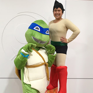 Astro Boy stilt walker meets Teenage Mutant Ninja Turtle Leonardo