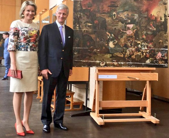 King Philippe and Queen Mathilde visited the painting restoration workshop of the Royal Institute for Cultural Heritage. Mathilde wore Dries Van Noten dress