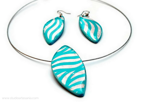 Photo of jewelry set (necklace and earrings) in turquoise blue and silver