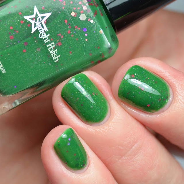 green nail polish with glitter swatch