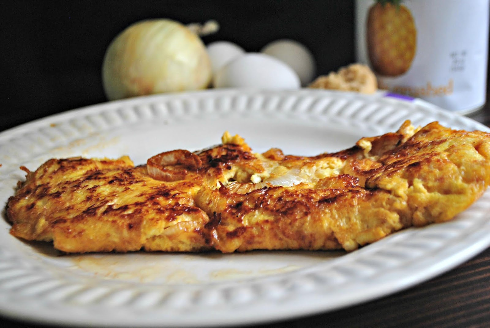 Sweet breakfast omelette recipe with Hawaiian flavors from onion, brown sugar, and pineapple