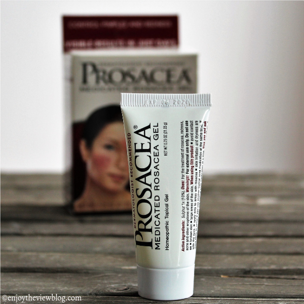 tube of Prosacea gel standing on a wooden surface with the product box in the background