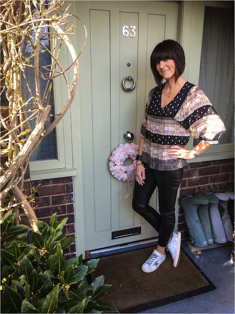 My Midlife Fashion, Mango boho tiered top, zara faux leather leggings, golden goose trainers, mango cuff bracelet