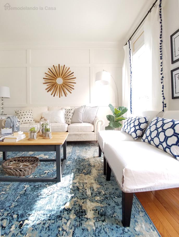 rustic coffee table, sunburst mirror, slipper chairs,